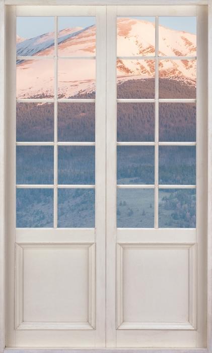 Fototapeta winylowa Białe drzwi - Konie - Widok przez drzwi