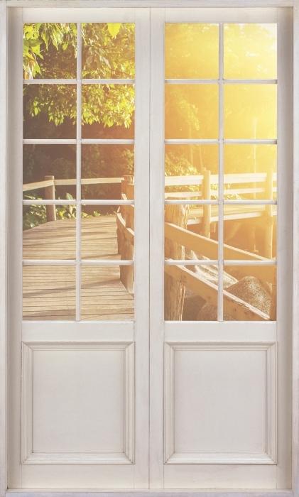 Papier peint vinyle Porte Blanche - Thaïlande - La vue à travers la porte