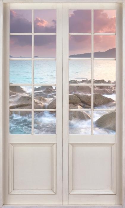 Papier peint vinyle Porte Blanche - Coucher De Soleil - La vue à travers la porte