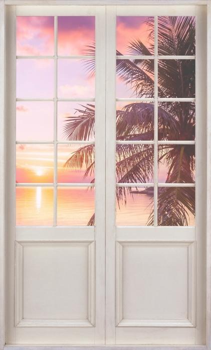 Fototapeta winylowa Białe drzwi - Tropikalna plaża - Widok przez drzwi