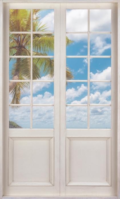 Vinyl Fotobehang Witte deur - Paradise op het strand - Uitzicht door de deur