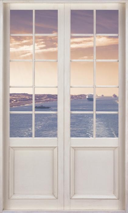 Vinyl-Fototapete Weiße Tür - Entlang des Flusses - Blick durch die Tür