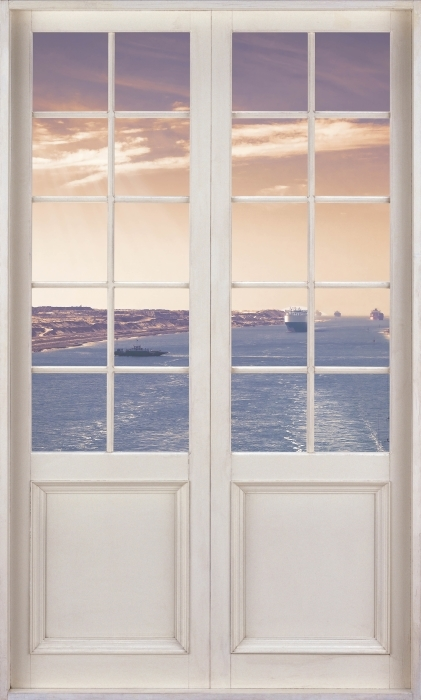Papier peint vinyle Porte Blanche - Le Long De La Rivière - La vue à travers la porte