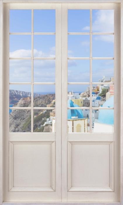 Fototapet av Vinyl Vit dörr - Landskap av Santorini - Se genom dörren