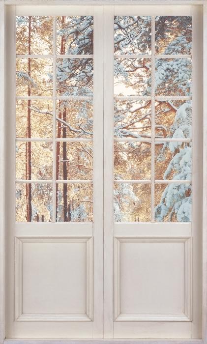 Fototapeta winylowa Białe drzwi - Sosny pokryte śniegiem - Widok przez drzwi