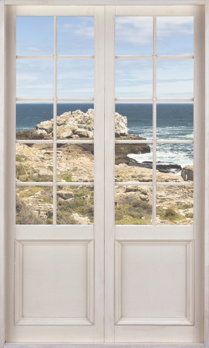 Fototapeta winylowa Białe drzwi - Nad morzem. - Widok przez drzwi