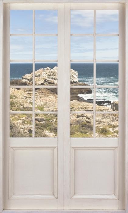 Papier peint vinyle Porte Blanche - La Mer. - La vue à travers la porte