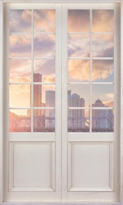 Vinyl Fotobehang White door - Brisbane. - Uitzicht door de deur