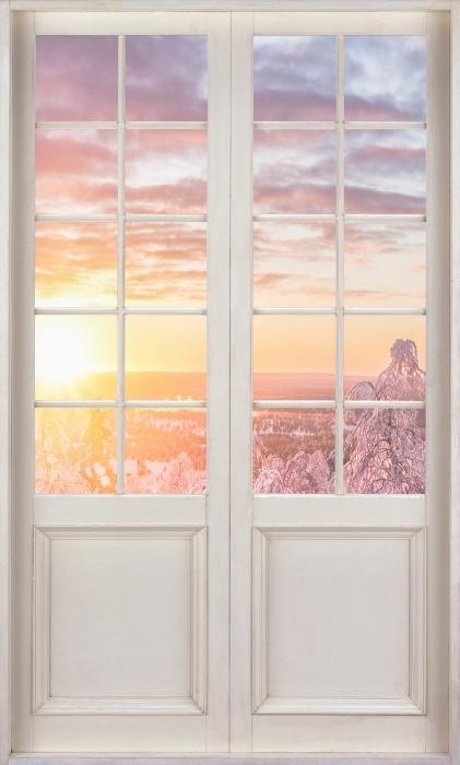 Fototapeta winylowa Białe drzwi - Skandynawia o zachodzie słońca - Widok przez drzwi