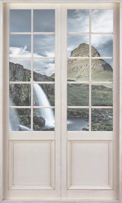 Papier peint vinyle Porte Blanche - Cascade. Islande. - La vue à travers la porte