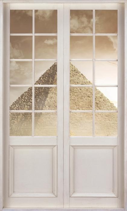 Papier peint vinyle Porte Blanche - Désert - La vue à travers la porte