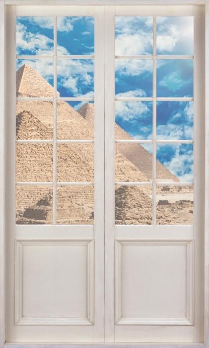 Vinyl Fotobehang White door - Egypte - Uitzicht door de deur