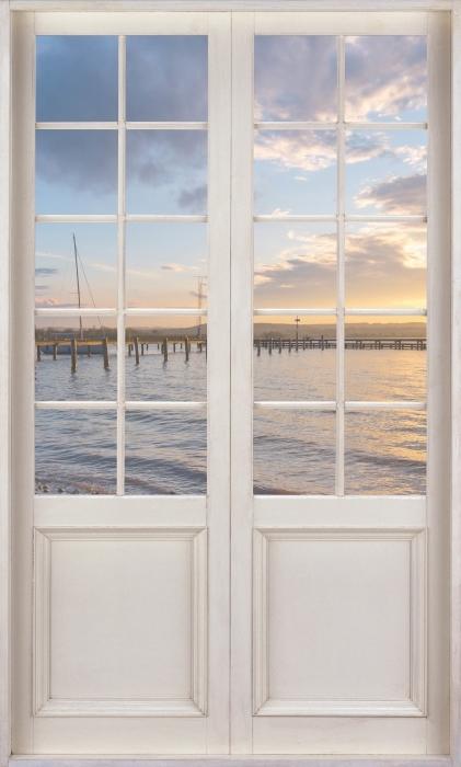 Papier peint vinyle Porte Blanche - Mara - La vue à travers la porte