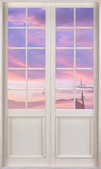Fototapeta winylowa Białe drzwi - Niesamowity zachód słońca w porcie w Bostonie - Widok przez drzwi