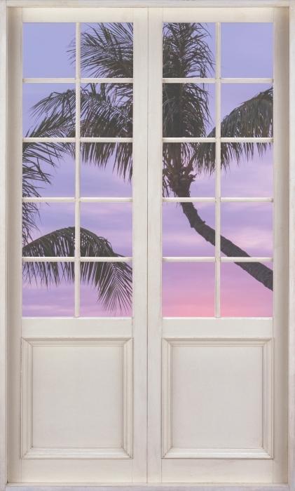 Papier peint vinyle Porte Blanche - Palma - La vue à travers la porte