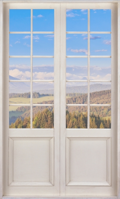 Papier peint vinyle Porte Blanche - Pieniny. Pologne. - La vue à travers la porte