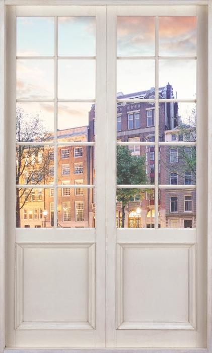 Fotomural Estándar Puerta blanca - Ámsterdam. Países Bajos. - Vistas a través de la puerta