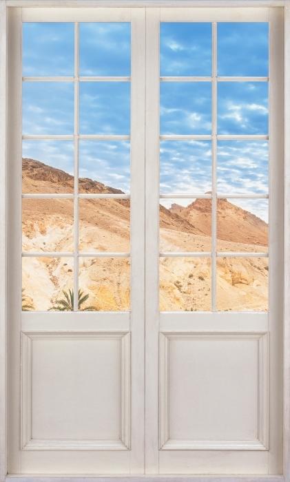 Vinyl Fotobehang White door - Mountain oasis - Uitzicht door de deur