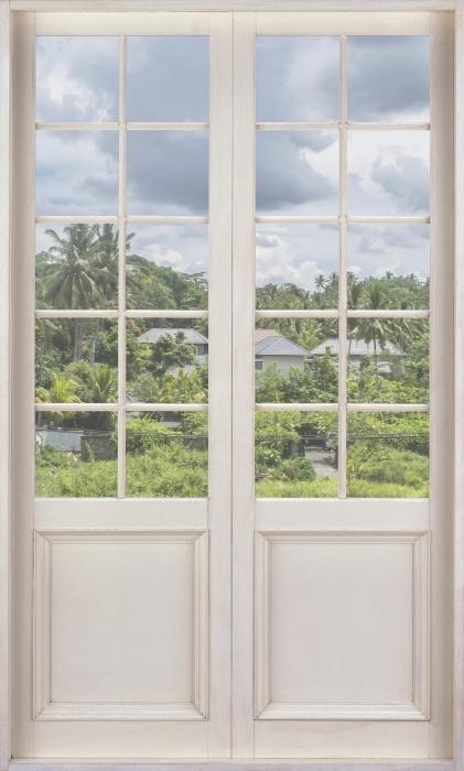 Fototapeta winylowa Białe drzwi - Pole ryżowe - Widok przez drzwi