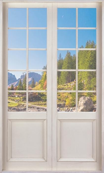 Papier peint vinyle Blanc Porte - Lac Bleu. Suisse. - La vue à travers la porte