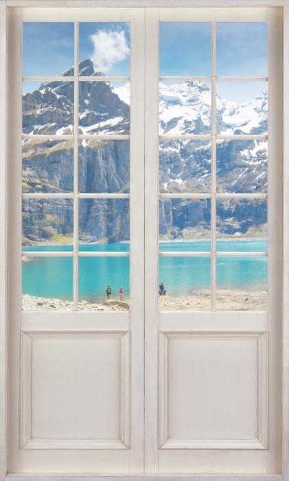 Papier peint vinyle Porte Blanche - Lac. Suisse - La vue à travers la porte