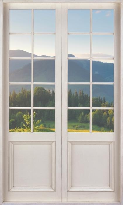 Papier peint vinyle Porte Blanche - Vallée De Montagne - La vue à travers la porte