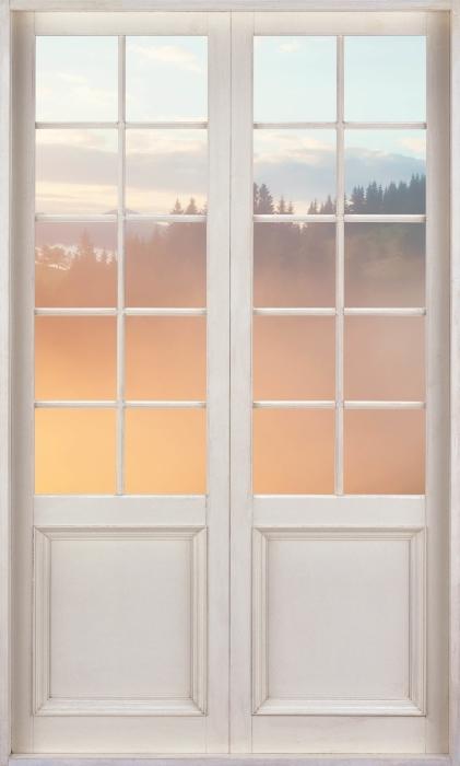 Fototapeta winylowa Białe drzwi - Górskie doliny podczas wschodu słońca - Widok przez drzwi