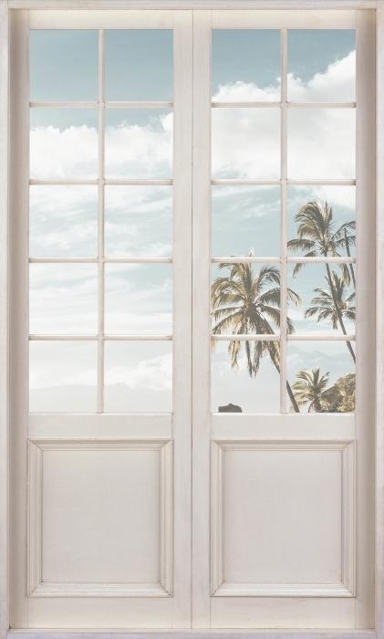 Fototapeta winylowa Białe drzwi - Palmy. Hawaje. - Widok przez drzwi