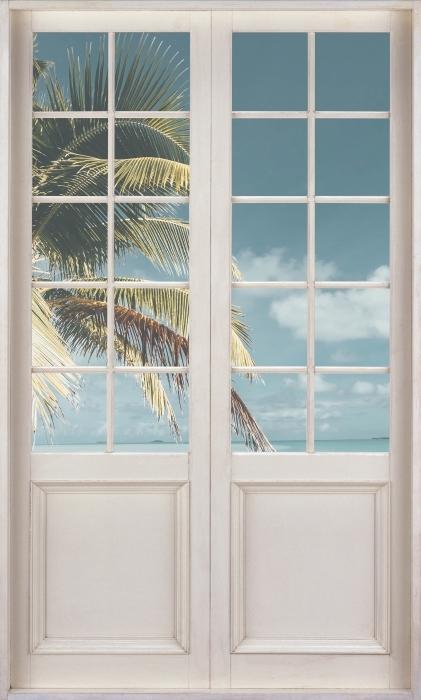 Papier peint vinyle Porte Blanche - Cuisine Arbre Palm Island - La vue à travers la porte