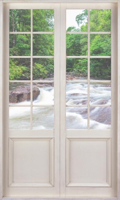 Vinyl-Fototapete Weiße Tür - Wasserfall im Wald - Blick durch die Tür