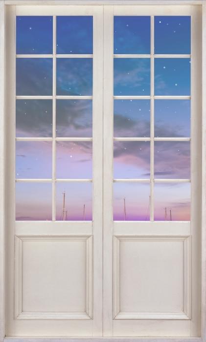 Vinyl-Fototapete Weiße Tür - Mallorca. - Blick durch die Tür
