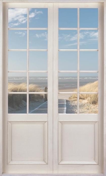 Vinyl-Fototapete Weiße Tür - Nordsee Strand auf Langeoog - Blick durch die Tür