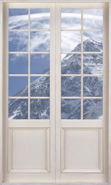 Papier peint vinyle Porte Blanche - Le Mont Everest - La vue à travers la porte