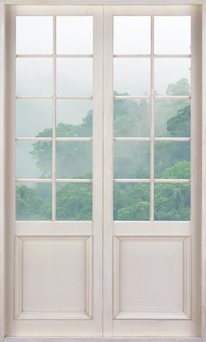 Fototapeta winylowa Białe drzwi - Lasy deszczowe - Widok przez drzwi