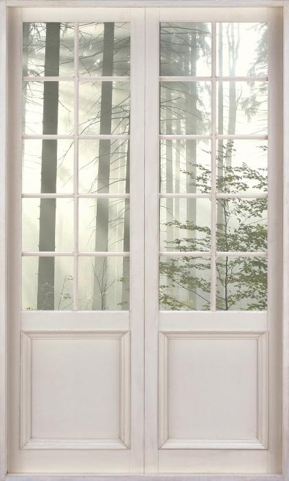 Papier peint vinyle Porte Blanche - Forêt De Conifères Un Jour D'Automne Brumeux - La vue à travers la porte