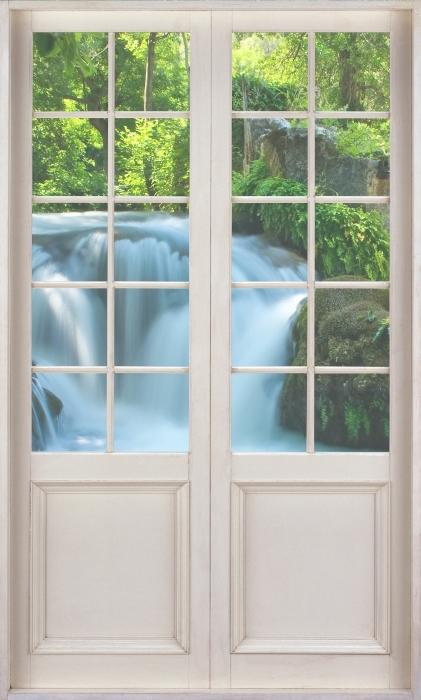 Fototapet av Vinyl Vit dörr - Vattenfall - Se genom dörren