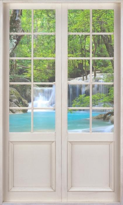 Vinyl Fotobehang White door - Erawan Waterfall. Thailand - Uitzicht door de deur