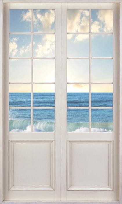 Papier peint vinyle Porte Blanche - Mer. Coucher Du Soleil. - La vue à travers la porte