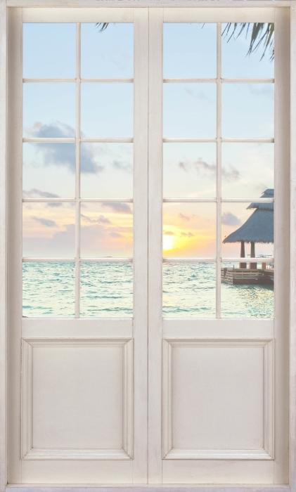 Fototapeta winylowa Białe drzwi - Hamak i słońce - Widok przez drzwi