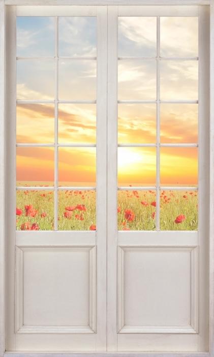 Fotomural Estándar Puerta blanca - Campo de amapolas - Vistas a través de la puerta