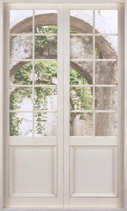 Papier peint vinyle Porte Blanche - Arcade - La vue à travers la porte