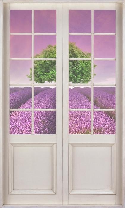 Fototapeta winylowa Białe drzwi - Letni krajobraz - Widok przez drzwi