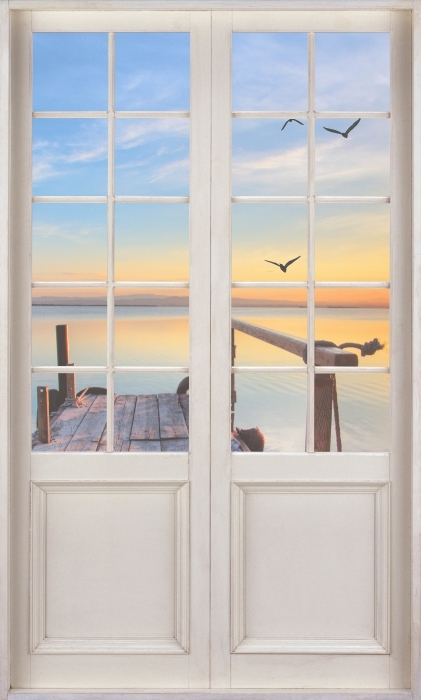Vinyl Fotobehang White door - Lake - Uitzicht door de deur