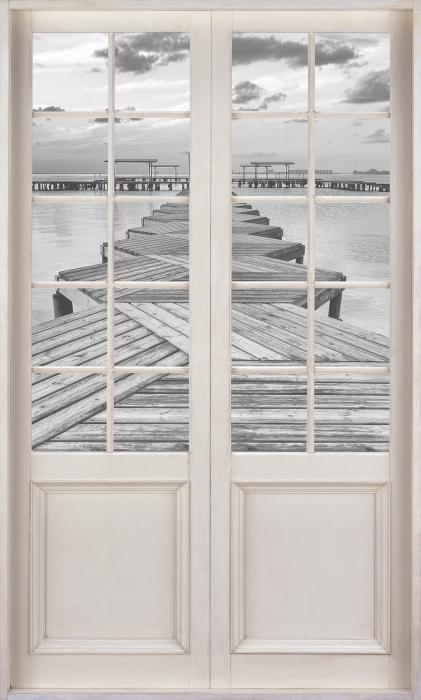 Papier peint vinyle Porte Blanche - Marina - La vue à travers la porte