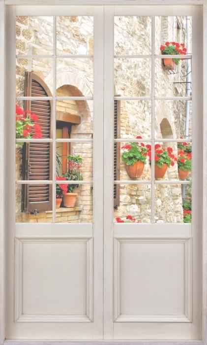 Papier peint vinyle Porte Blanche - Colline Italienne - La vue à travers la porte