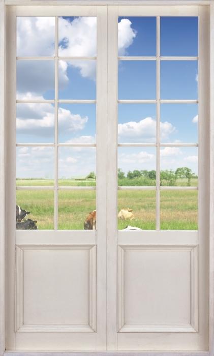Fototapeta winylowa Białe drzwi - Łąka - Widok przez drzwi