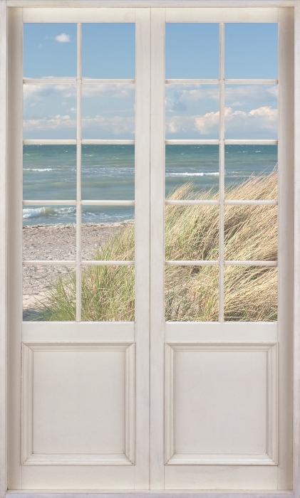 Fototapeta winylowa Białe drzwi - Morze - Widok przez drzwi