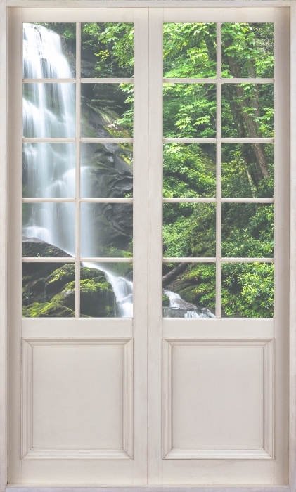 Fotomural Estándar Puerta blanca - Cascada en el bosque - Vistas a través de la puerta