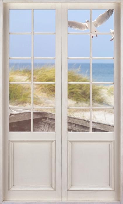 Vinyl-Fototapete Weißer Tür - Strand am Meer - Blick durch die Tür