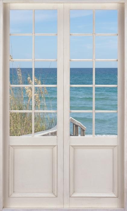Fototapeta winylowa Białe drzwi - Wydmy - Widok przez drzwi
